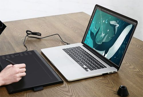 Huion Inspiroy H1060P Graphics Drawing Tablet connected with a computer